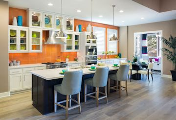 Kitchen with glass tile backsplash from counter to ceiling